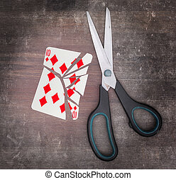 Concept of addiction, card with scissors, ten of diamond