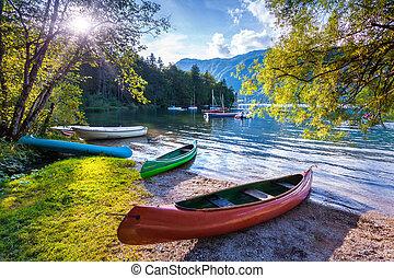 Bohinj Lake with boats, Triglav National Park, Julian Alps,...