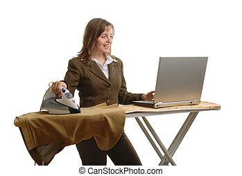 Bussiness woman with laptop and iron - Young attractive and...