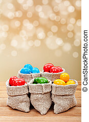 Colorful easter eggs in burlap bags