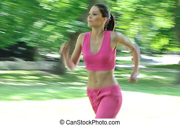 Young woman running outdoor - motion blurr - Young person...