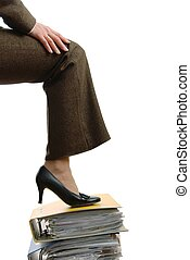 Business womans leg stepping onto documents