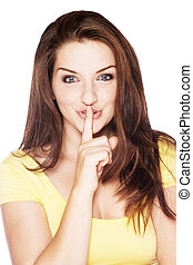 Beautiful woman saying shh - A beautiful young woman with...