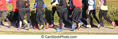 women during the cross-country race in public park