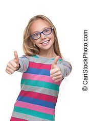 Preteen girl in a glasses with her thumbs up - A preteen...