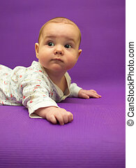 Infant on a purple background. - Baby on a purple...