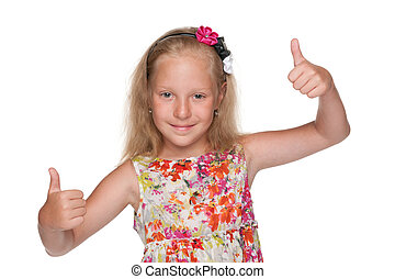Cute little girl holds her thumbs up