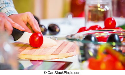 Chopping Tomatoes At The Kitchen - Shot of cutting tomatoes...