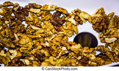 Walnuts Being Loaded Into Mincing Machine - Close-up footage...