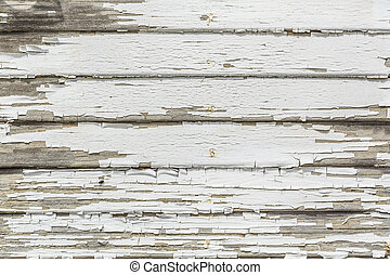 White Peeling Paint - The white peeling paint on the wood...