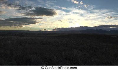 Sunset Pan of Mountain Range - Sunset rays to lighten up the...