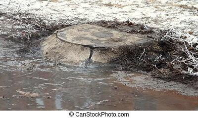 Manholes accident on street , water flows over the road from...