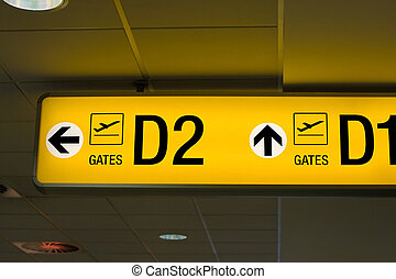Departure gate sign in the airport - Yellow glowing gate...