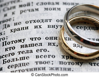Wedding rings and the bible in Russian