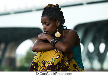 moment of solitude - African American woman sits and thinks
