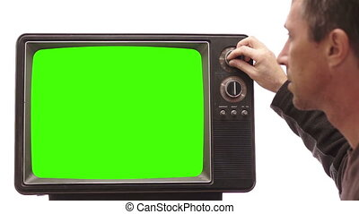 Male Turning Channel on Vintage TV