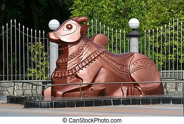 Nandi Statue - Copper colored Nandi statue at the entrance...