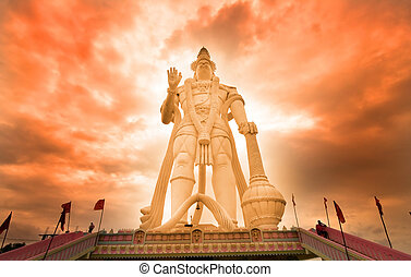 Hanuman - Hindu god Hanuman with cloudy red sky background