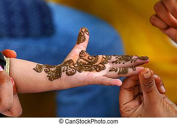 Mehendi Art - Decorating baby hand with traditional Mehendi...