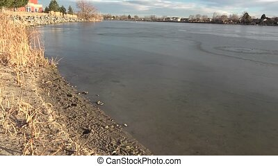 Thin Ice on Residential Lake - Great view of residential...