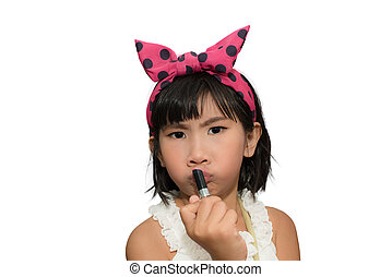 Cute girl making up her face with lipstick