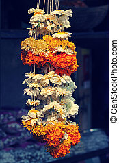 Flower garlands for sale. Flower garlands being sold on the...