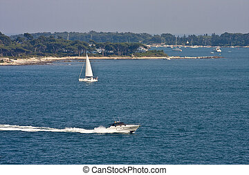 Sailboat and Cabin Cruiser in Bay - Luxury boats in the calm...