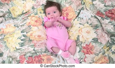 Cute Baby Resting - Baby girl lying on rose blanket after...