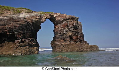Stone arches on Playa de las Catedrales during outflow,...