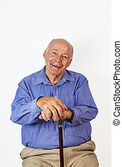 happy elderly man sitting in a chair with his walking stick