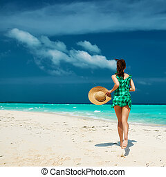 Woman in green dress at beach - Woman in green dress at...