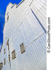 Grain Elevator - The details of a silver grain elevator with...