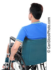 injured man in wheelchair - back view of injured man in...