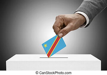 Black male holding flag Voting concept - Democratic Republic...