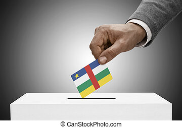 Black male holding flag. Voting concept - Central African...