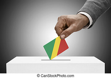 Black male holding flag Voting concept - Congo-Brazzaville -...