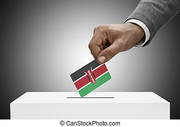 Black male holding flag. Voting concept - Kenya