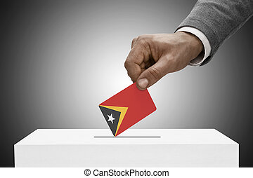 Black male holding flag. Voting concept - East Timor