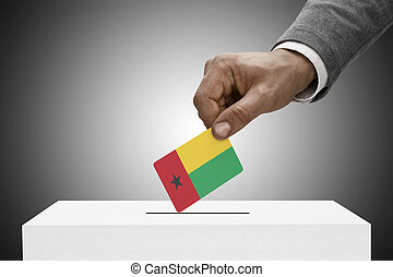 Black male holding flag Voting concept - Guinea-Bissau