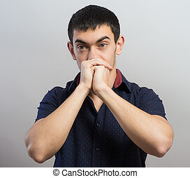 Portrait of praying man