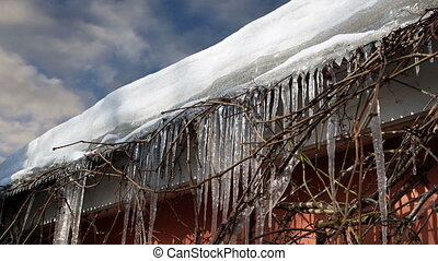 Icicles on the roof  (time lapse)