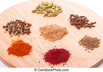 Spices on the kitchen board - Seven spices pepper, adjika,...
