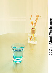Water glass on wood table