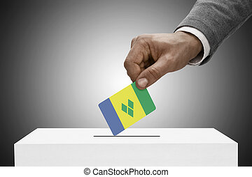 Black male holding flag. Voting concept - Saint Vincent and...