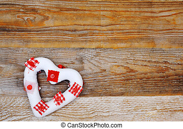 love symbol heart on wooden background