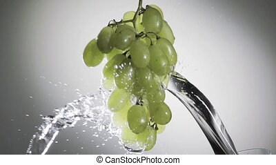 green grapes in a spray of water - Dynamic image of a bunch...