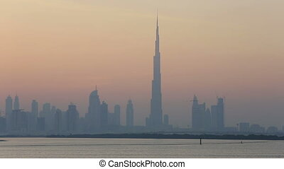 view of Dubai skyscraper and Burj Khalifa at sunset United...