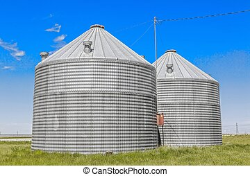 Steel Grain Bins - A pair of steel grain bins used by...