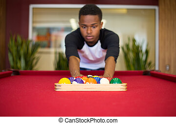 Playing pool - Closeup portrait, young man hanging out,...