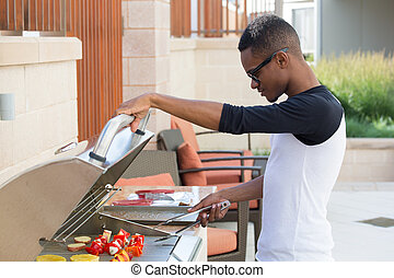 Grilling - Closeup portrait, handsome young guy with big...